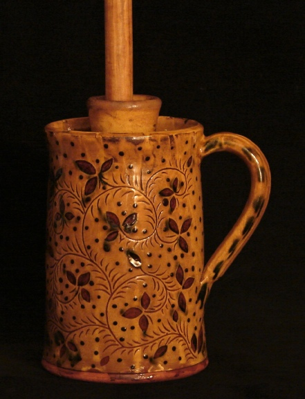 redware butter churn, ivy leaves